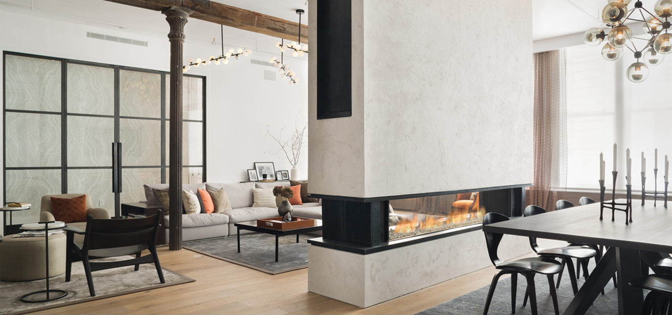 8' linear see-through fireplace in Duane Street New York. Tribeca loft's long linear see-through firepace wtih clear fireglass